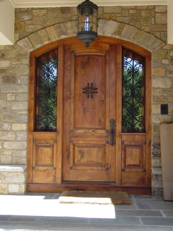 modern-stone-wall-entry-wood-exterior-doors